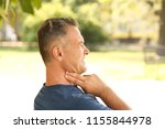 man checking pulse outdoors on... | Shutterstock . vector #1155844978