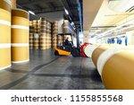 storage of paper rolls in a... | Shutterstock . vector #1155855568