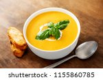 bowl of squash soup with basil... | Shutterstock . vector #1155860785