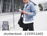 the man expects his flight at... | Shutterstock . vector #1155911602