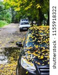 black car covered with yellow... | Shutterstock . vector #1155918322