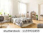 an interior of a bedroom with... | Shutterstock . vector #1155931855