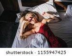 overhead portrait of cute... | Shutterstock . vector #1155947425