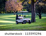 Golf Cart Parked. Trees In...