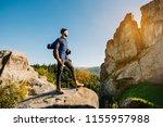 a traveler man standing on the... | Shutterstock . vector #1155957988