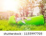 young woman resting on an air... | Shutterstock . vector #1155997705