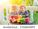 children drink colorful healthy ... | Shutterstock . vector #1156005895