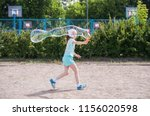 A Little Girl Runs In The Park...