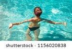 woman in black bikini swimming... | Shutterstock . vector #1156020838