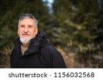 portrait of a senior man ... | Shutterstock . vector #1156032568
