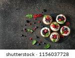 slate plate with tasty tartlets ... | Shutterstock . vector #1156037728