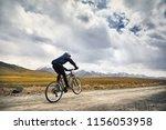 man on mountain bike rides on... | Shutterstock . vector #1156053958