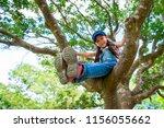 girl climbing a tree | Shutterstock . vector #1156055662
