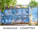 old rusty blue gate with... | Shutterstock . vector #1156097965