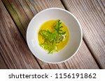 a citronella plant leaf resting ... | Shutterstock . vector #1156191862