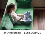 Relaxed Woman Using Laptop...