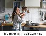 smiling loving single mother... | Shutterstock . vector #1156208452
