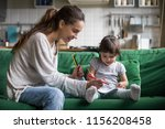 smiling baby sitter and... | Shutterstock . vector #1156208458
