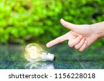 the female hand indicates the... | Shutterstock . vector #1156228018