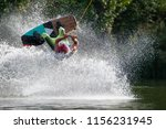 wakeboarder make a trick on a... | Shutterstock . vector #1156231945