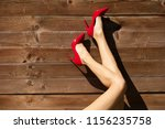 female wearing red high heels.  | Shutterstock . vector #1156235758