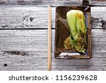 cooked bok choi on plate | Shutterstock . vector #1156239628