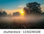 beautiful misty sunrise... | Shutterstock . vector #1156240108