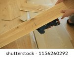 skilled worker whit stroke saw... | Shutterstock . vector #1156260292