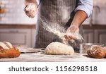 hands of the baker's male... | Shutterstock . vector #1156298518