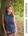 outdoor portrait of young... | Shutterstock . vector #1156303132