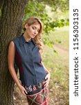 outdoor portrait of young... | Shutterstock . vector #1156303135