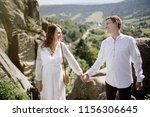 happy pregnant couple hugging...   Shutterstock . vector #1156306645