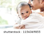 mother kiss and holding baby in ... | Shutterstock . vector #1156369855
