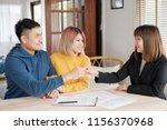 asian happy couple getting key... | Shutterstock . vector #1156370968
