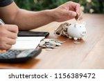 saving money concept man hand... | Shutterstock . vector #1156389472