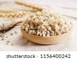 cooked peeled barley grains in... | Shutterstock . vector #1156400242