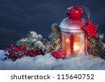 Burning Lantern In The Snow At...