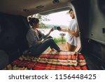 couple resting outside. car...   Shutterstock . vector #1156448425