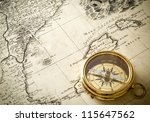 old compass on vintage map 1732 | Shutterstock . vector #115647562