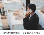 business man using mobile phone ... | Shutterstock . vector #1156477768