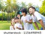 lovely asian family enjoyed...   Shutterstock . vector #1156498945
