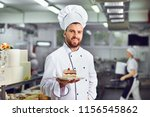 a confectioner with dessert in... | Shutterstock . vector #1156545862