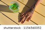 hand with mehendi on black... | Shutterstock . vector #1156560352