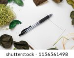 paper note with a pen and dead... | Shutterstock . vector #1156561498