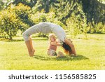 young woman doing yoga with... | Shutterstock . vector #1156585825