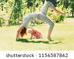 young woman doing yoga with... | Shutterstock . vector #1156587862