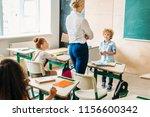 teacher walking by classroom... | Shutterstock . vector #1156600342
