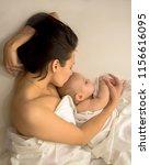 mother and newborn baby sleep... | Shutterstock . vector #1156616095