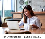 asain woman working with laptop ... | Shutterstock . vector #1156645162