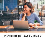 asain woman working with laptop ... | Shutterstock . vector #1156645168